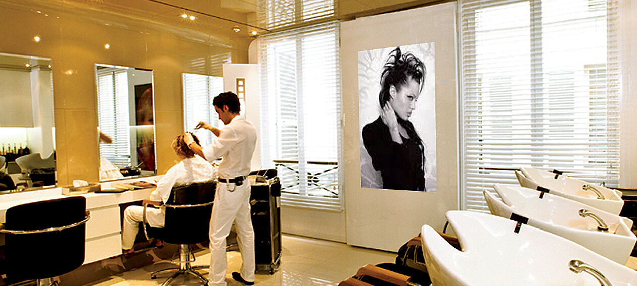 "84.0"" Glass TV for commercial application, installed in a hairdresser environment @ Salon Dessange Paris in France."